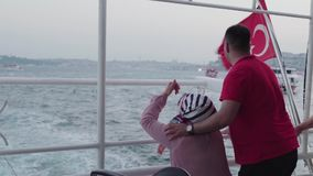 Turkish Couple floating on the ship on the Bosphorus and talking. stock video footage
