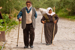 Turkish couple walks along stone path Stock Photography