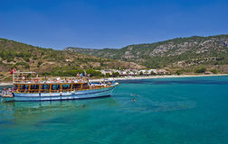 Turkish cruise boat. Boat with tourists moored near Turkish aegean coast. With its shimmering turquoise waters, 3000-year history, sunny weather and abundance of Royalty Free Stock Images