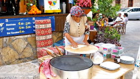 The Turkish cuisine. ANTALYA, TURKEY - MAY 6, 2017: The elderly cook prepares gozleme - Turkish flatbread with toppings - cheese, potato or spinach, on May 6 in stock video