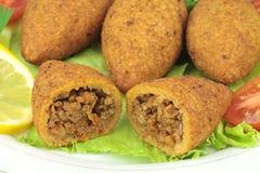 Turkish cuisine, bulgur coated meatballs  ( icli kofte ) Royalty Free Stock Image