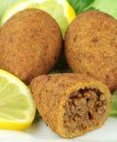Turkish cuisine, bulgur coated meatballs  ( icli kofte ) Stock Photography