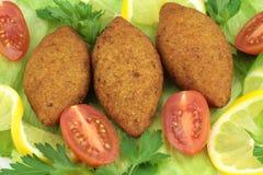 Turkish cuisine, bulgur coated meatballs  ( icli kofte ) Stock Images