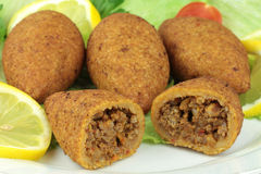 Turkish cuisine, bulgur coated meatballs  ( icli kofte ) Stock Photos