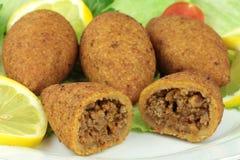 Turkish cuisine, bulgur coated meatballs  ( icli kofte ) Stock Photos