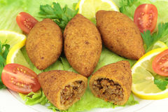 Turkish cuisine, bulgur coated meatballs  ( icli kofte ) Stock Photography