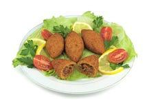 Turkish cuisine, bulgur coated meatballs  ( icli kofte ) Royalty Free Stock Photos