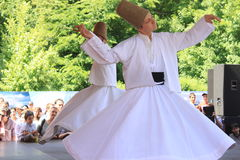 Whirling Dervish. In religious dancing at Turkish festival in Bucharest,Romania Royalty Free Stock Photos