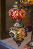 Turkish decorative lamps of glass mosaics in the bazaar Stock Photography