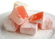 Turkish delight. On a white plate seen close-up stock photos