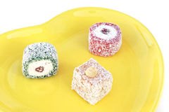 Turkish delight. In a decorative yellow plate Stock Image