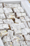 Turkish delight. With nuts sprinkled with powdered sugar and coconut stock image