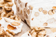 Turkish delight. Pieces of turkish delight nougat on wood desk royalty free stock photo