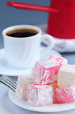 Turkish delight. (lokum) confection with black coffee and traditional coffee pot stock photo