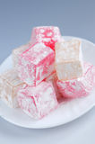 Turkish delight. (lokum) confection on a white dessert plate stock photography