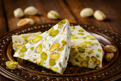 Turkish delight. Arabic dessert with and. Turkish arabic dessert with and Pistachios on wooden plate Stock Photo