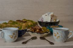 Turkish delight baklava and tea. Turkish delight, baklava and tea on the table in ethnic dishes stock photo