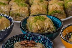 Turkish delight baklava and tea. Turkish delight, baklava and tea on the table in ethnic dishes royalty free stock photo