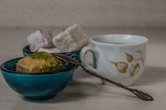 Turkish delight baklava and tea. Turkish delight, baklava and tea on the table in ethnic dishes royalty free stock image