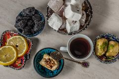 Turkish delight baklava and tea. Turkish delight, baklava and tea on the table in ethnic dishes stock photos