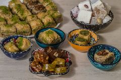 Turkish delight baklava and tea. Turkish delight, baklava and tea on the table in ethnic dishes stock image