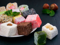 Turkish delight on black rustic background Stock Images