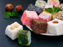 Turkish delight on black rustic background Royalty Free Stock Photography