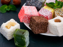 Turkish delight on black rustic background Royalty Free Stock Images