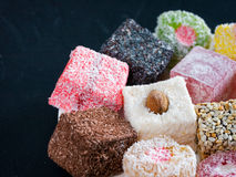 Turkish delight on black rustic background Royalty Free Stock Image
