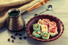 Turkish delight on clay plate with copper cezve Stock Image