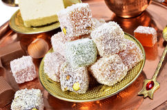 Turkish delight. Close-up of Turkish delight, halva and coffee on copper tray stock photography