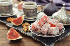 Turkish delight with coffee. Cup of coffee with turkish delight  and metal oriental tray on wooden background Stock Images