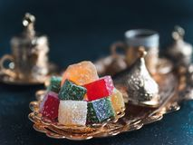 Turkish delight and turkish coffee. Turkish coffee with delight and traditional copper serving set on dark background. Assorted traditional turkish dilight or stock photography