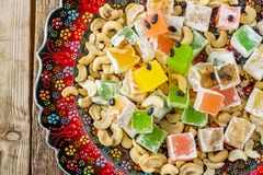 Turkish delight with colorful chocolate seeds and Royalty Free Stock Photography