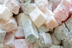 Turkish delight colorful pieces in powdered sugar. Rahat lokum traditional Turkish sweets, Turkey. Close up image stock photo