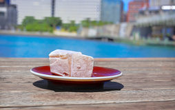 Turkish delight confection with black tasting coffee. Royalty Free Stock Image