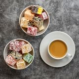 Turkish delight and cup of coffee on grey background. Top view royalty free stock photos