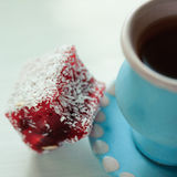 Turkish delight with cup of tea. Close up, selective focus Royalty Free Stock Images