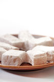 Turkish delight in a focus on a plate over white background Stock Photo