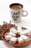 Turkish delight in a focus with raw coffee beans and cup of coff Stock Photos