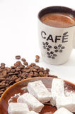 Turkish delight in a focus with raw coffee beans and cup of coff Royalty Free Stock Photo