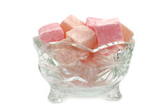 Turkish Delight in glass bowl on a white background Stock Photos