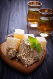Turkish delight, halva and tea. Selective focus Stock Photo