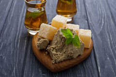 Turkish delight, halva and tea. Selective focus Royalty Free Stock Photo