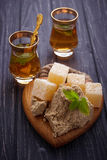 Turkish delight, halva and tea. Selective focus Stock Image