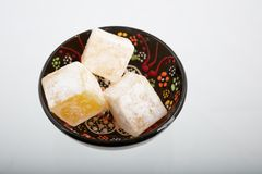 Tasty oriental sweets Turkish delight lokum. Turkish Delight lokum  close up high angle view sweetness, food, dessert, in a bowl Royalty Free Stock Photos