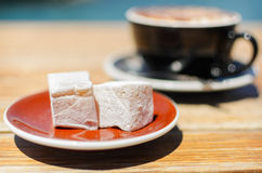 Turkish delight (lokum) confection with black tasting coffee. Royalty Free Stock Photos