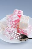 Turkish delight. Or lokum confection on a white dessert plate stock photography
