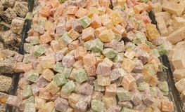 Turkish delight or lokum. Is a family of confections based on a gel of starch and sugar. The confection is often packaged and eaten in small cubes dusted with stock images