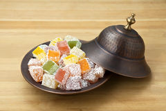 Turkish delight. Lokum or rahat lokum and many other transliterations is a family of confections based on a gel of starch and sugar Stock Photos
